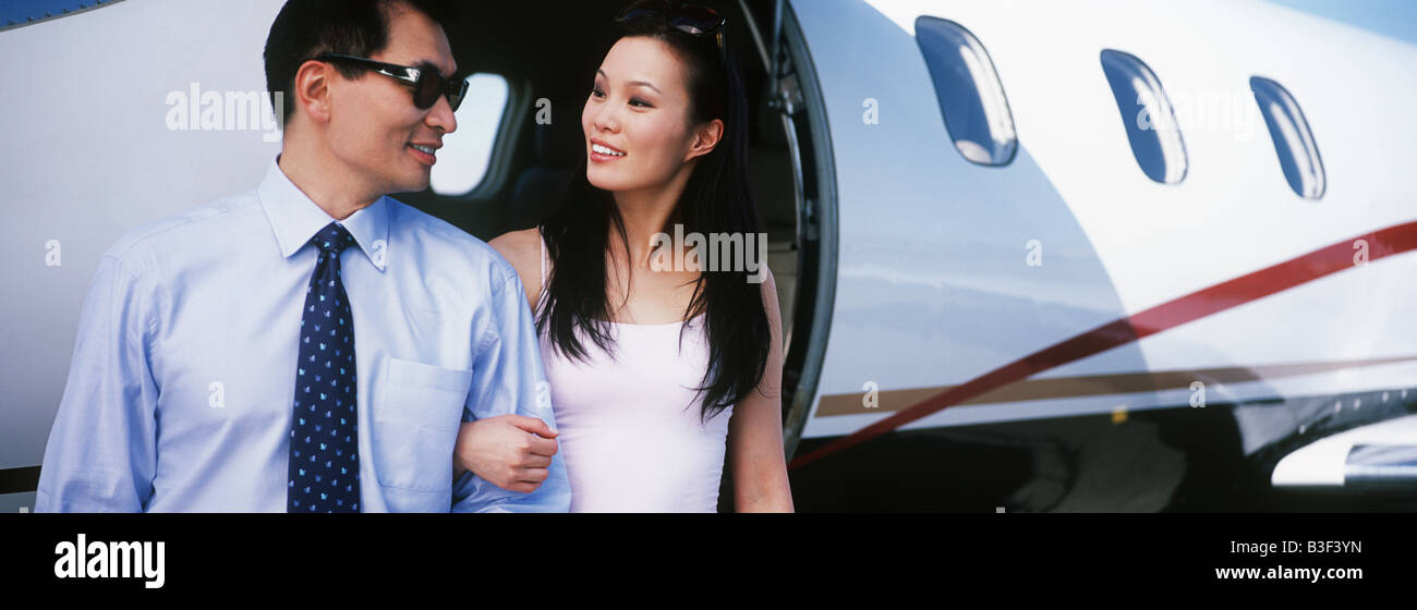 Couple exiting private plane - Stock Image