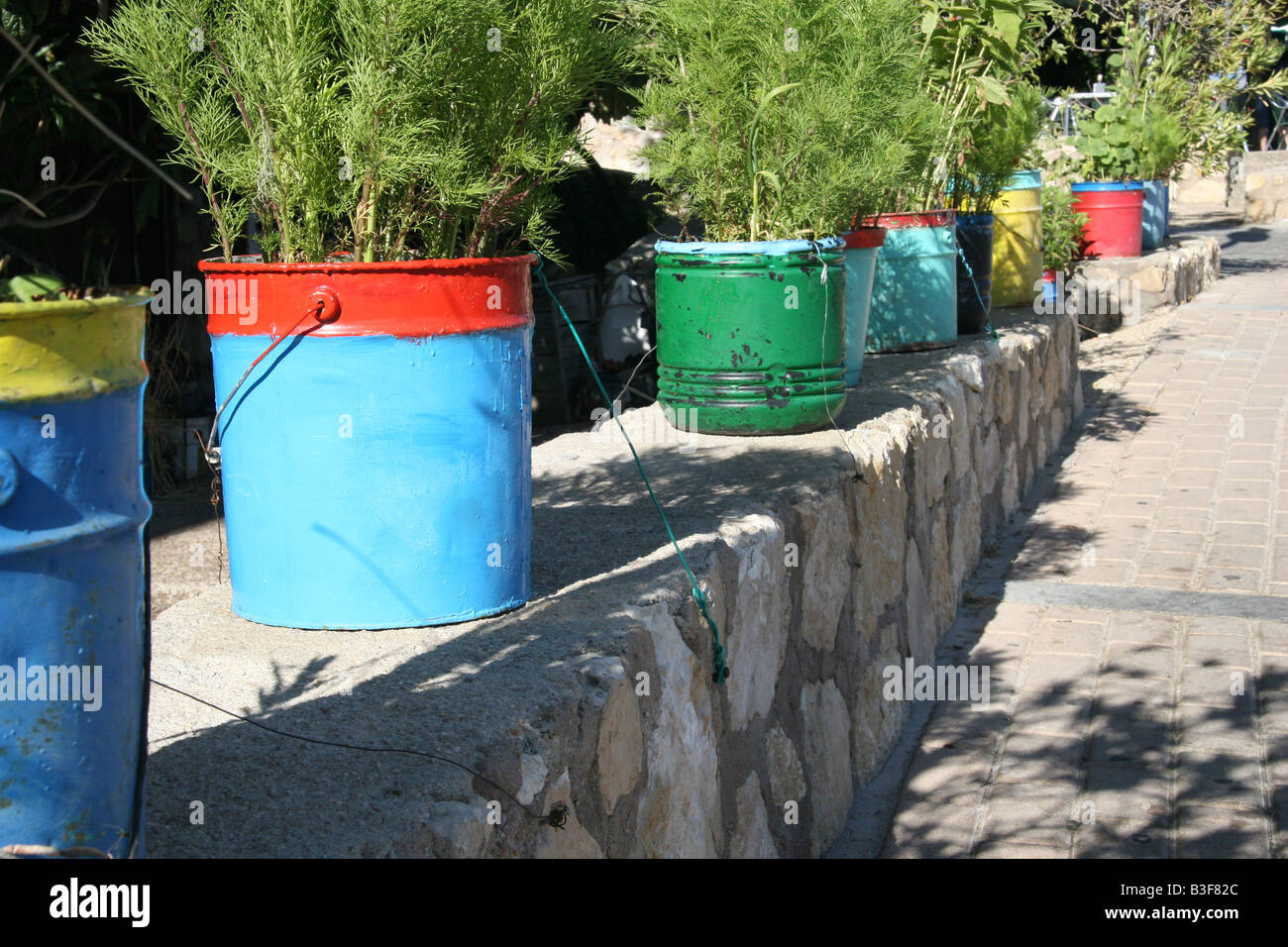 Multi colored plant buckets in Cuenca, Spain. - Stock Image