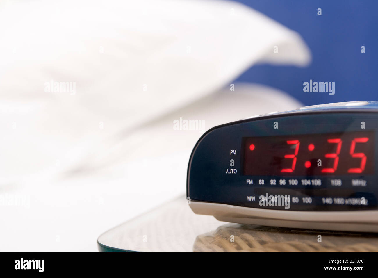 Empty bedroom with focus on alarm clock Stock Photo
