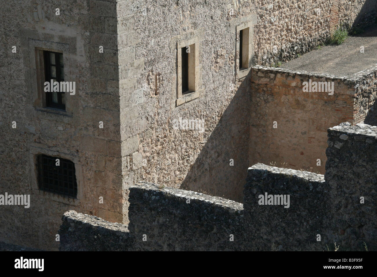 Old stone buildings and walls in Cuenca, Spain. - Stock Image