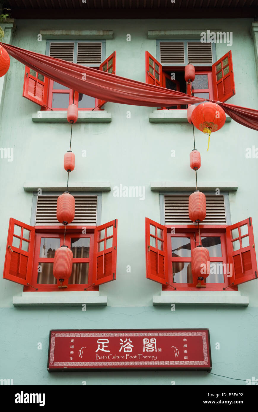 Red and green shophouse facade Chinatown, Singapore - Stock Image