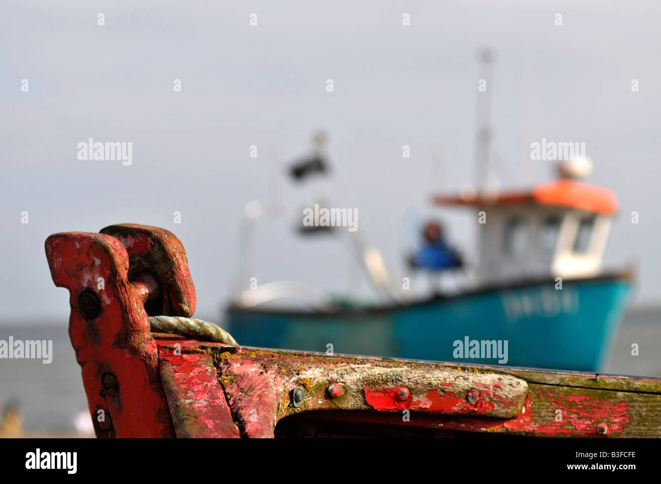 part of rusty boat with another in background - Stock Image