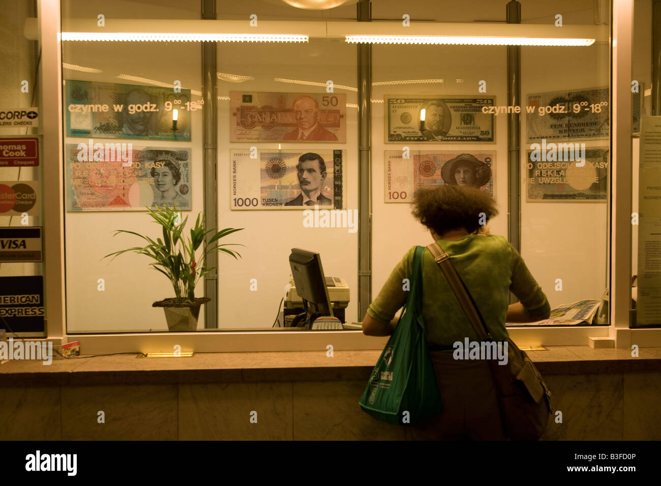 Woman exchanging dollars for Euros in Warsaw, Poland - Stock Image