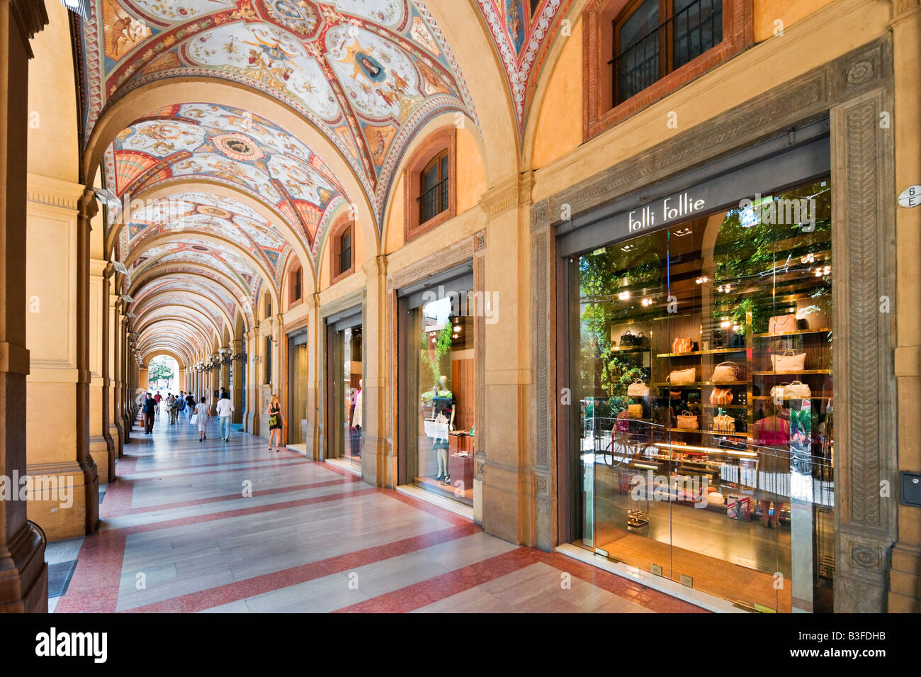 Exclusive shops in a portico on Via Farini in the historic centre, Bologna, Emilia Romagna, Italy - Stock Image
