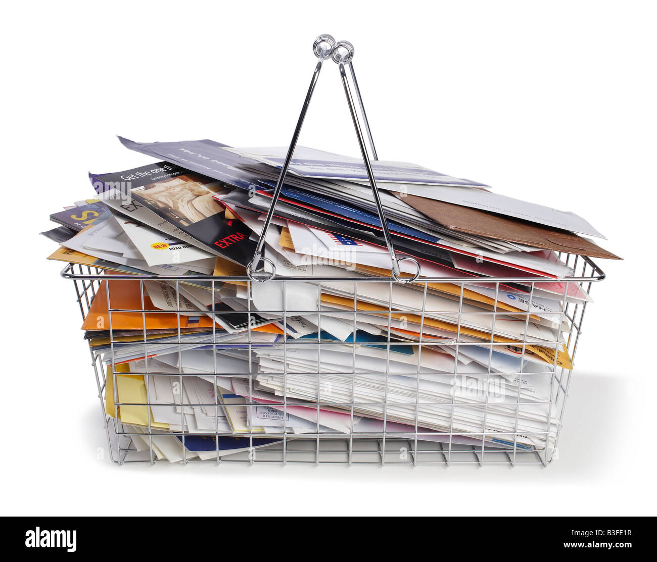 Shopping basket with junk mail - Stock Image
