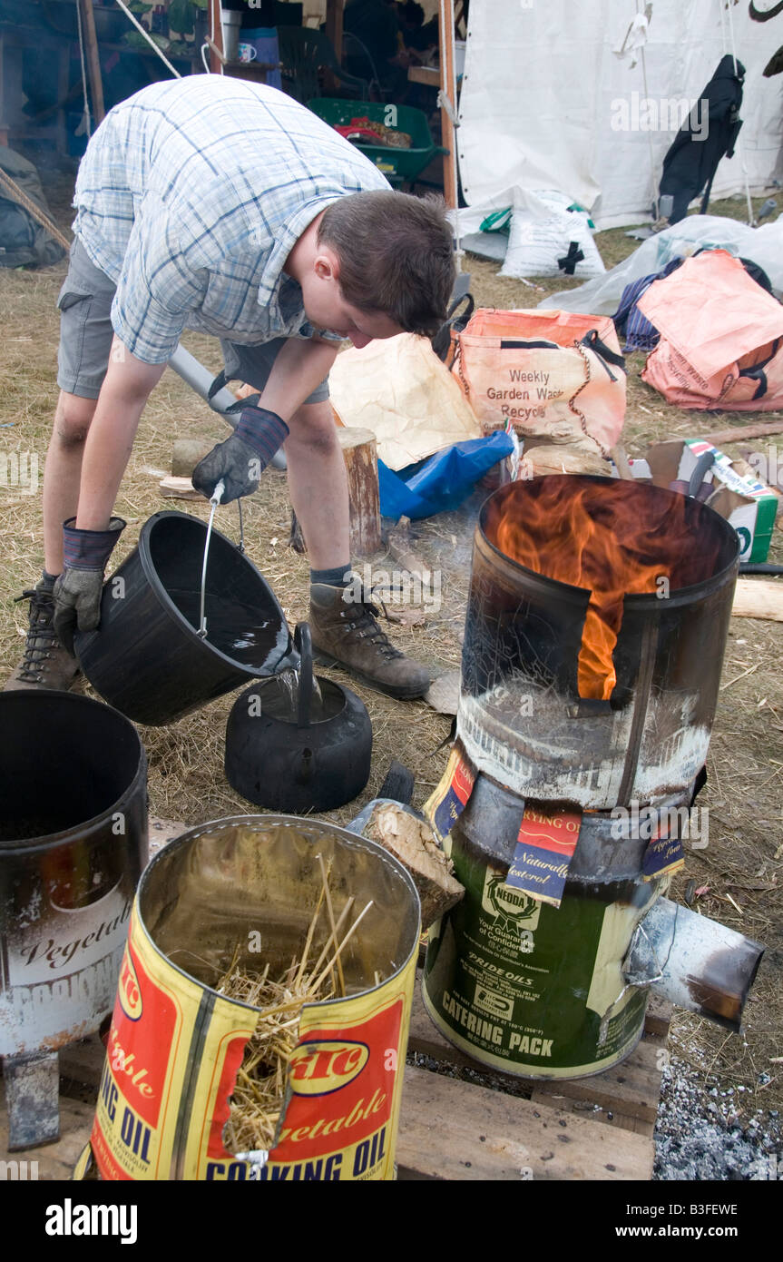 August 8th 2008 Climate Camp near Kingsnorth Power station Kent Rocket stoves made from old cooking oil tins - Stock Image