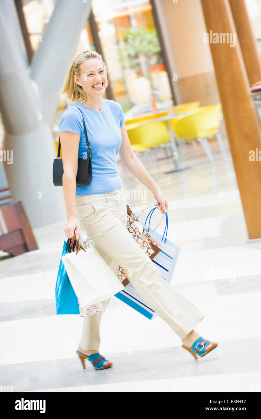 Woman with shopping bags at a shopping mall - Stock Image