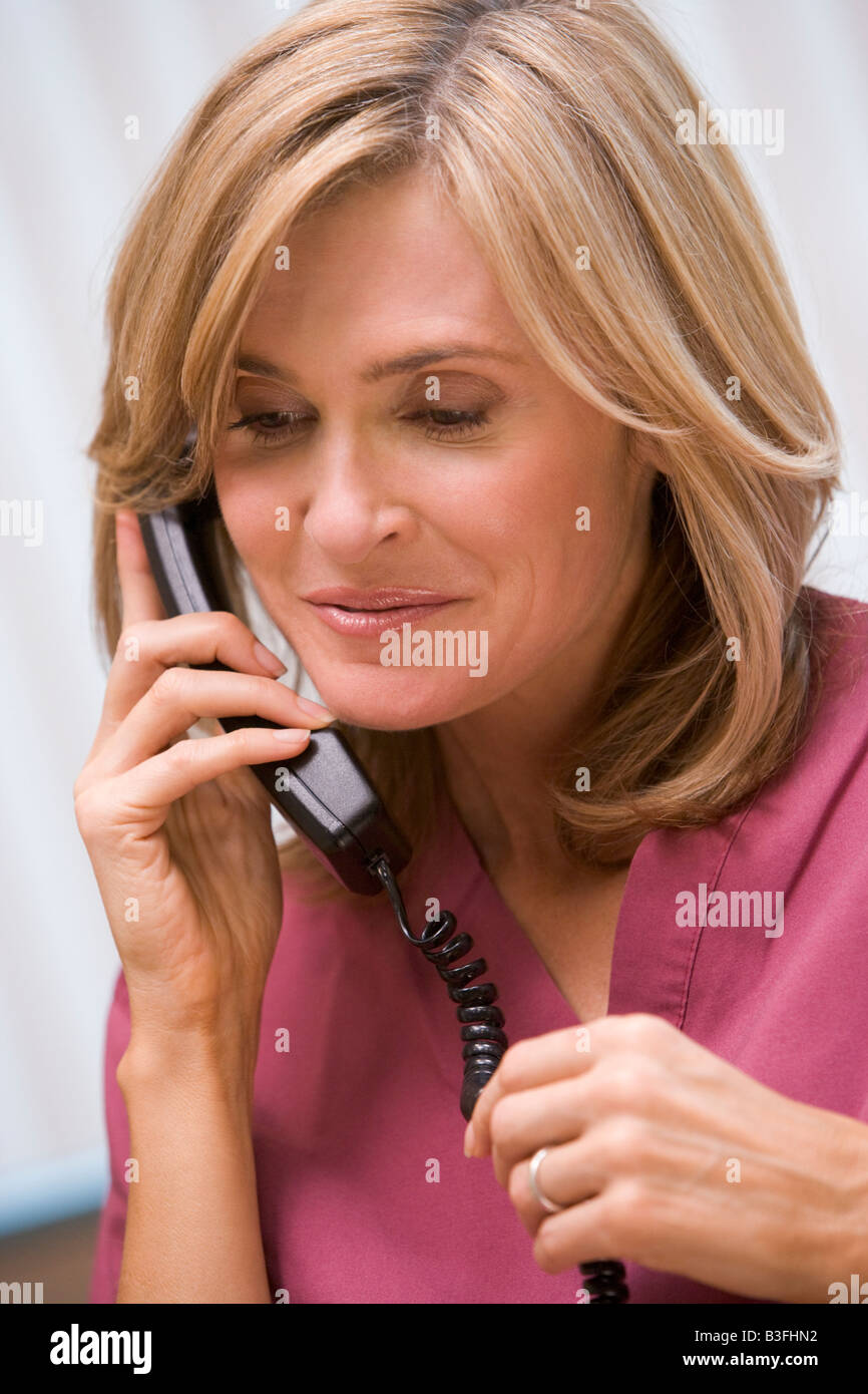 Consultant phoning client with good news - Stock Image