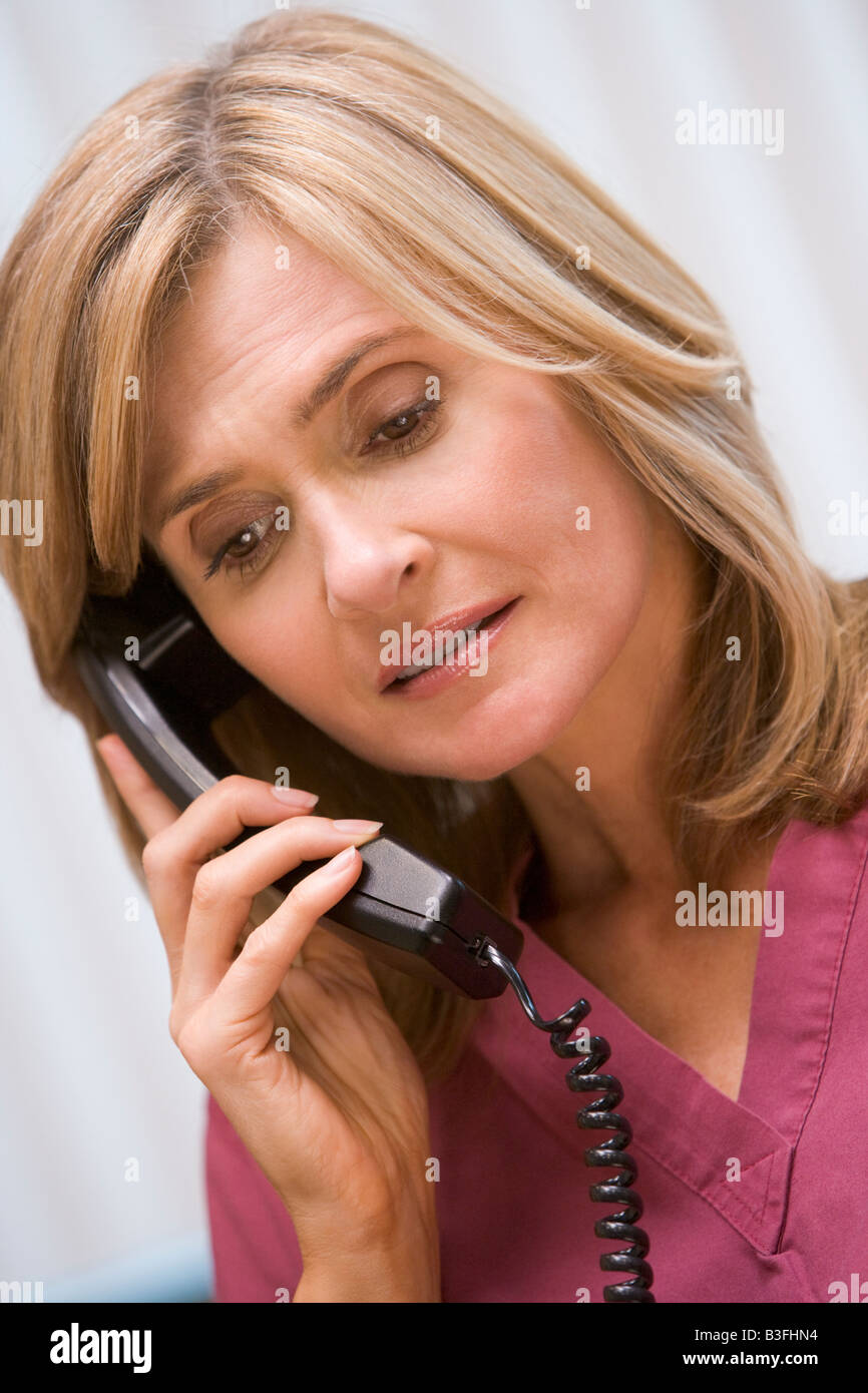 Consultant phoning client with bad news - Stock Image