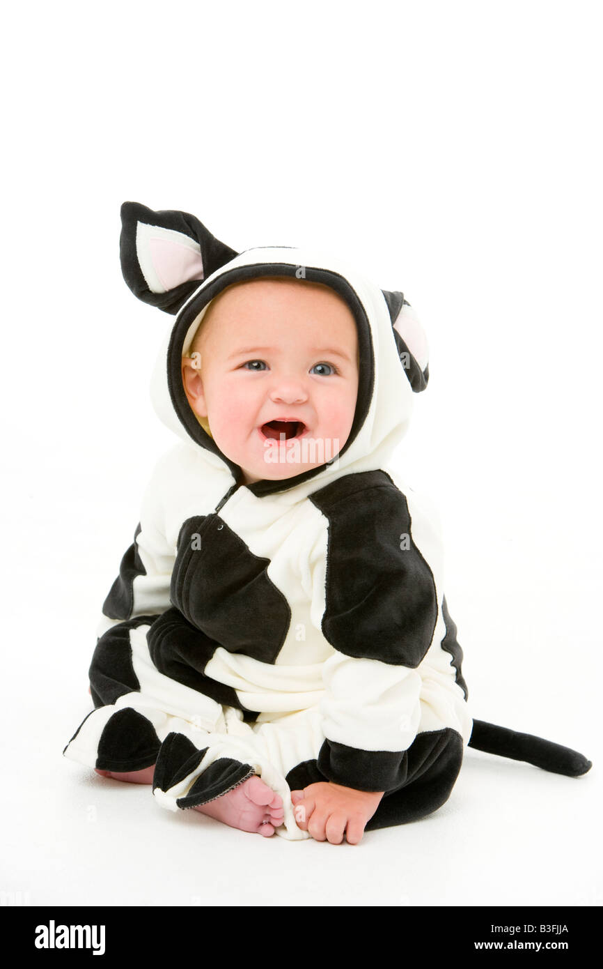 Baby in cow costume - Stock Image
