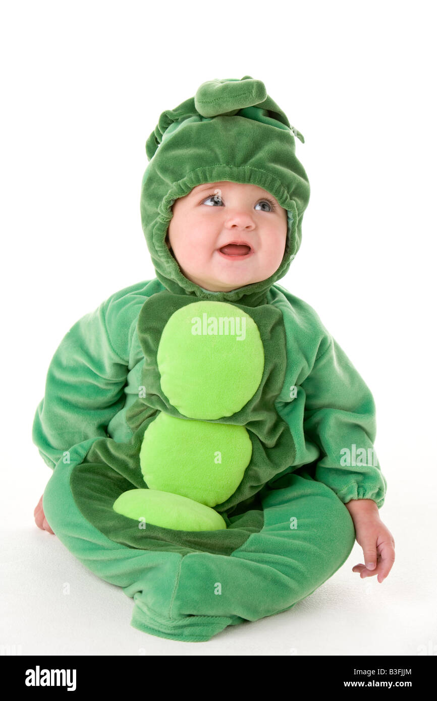 Baby in peas in pod costume - Stock Image
