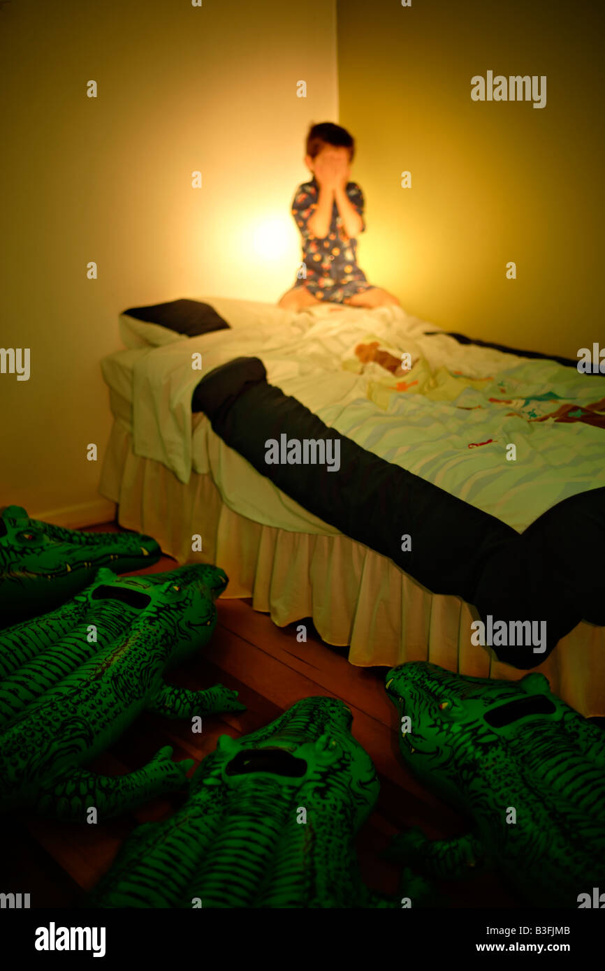 Inflatable crocodile series. Lurking by a child's bed - Stock Image