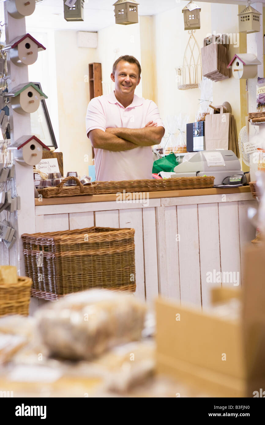 Man in birdhouse store smiling - Stock Image