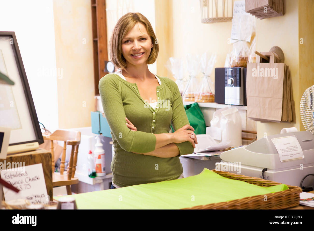 Woman in store smiling - Stock Image