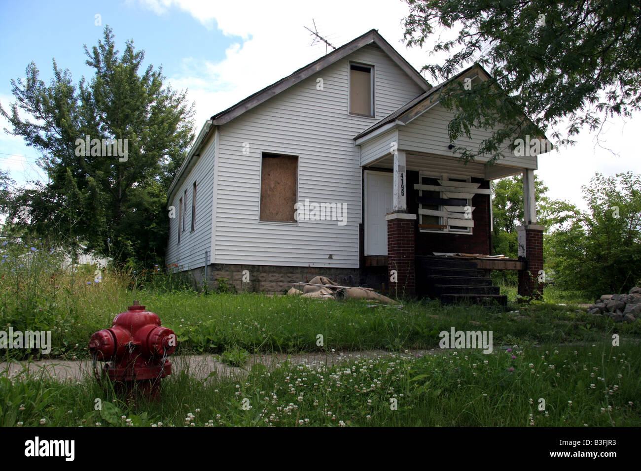 Boarded up house in Detroit Michigan - Stock Image