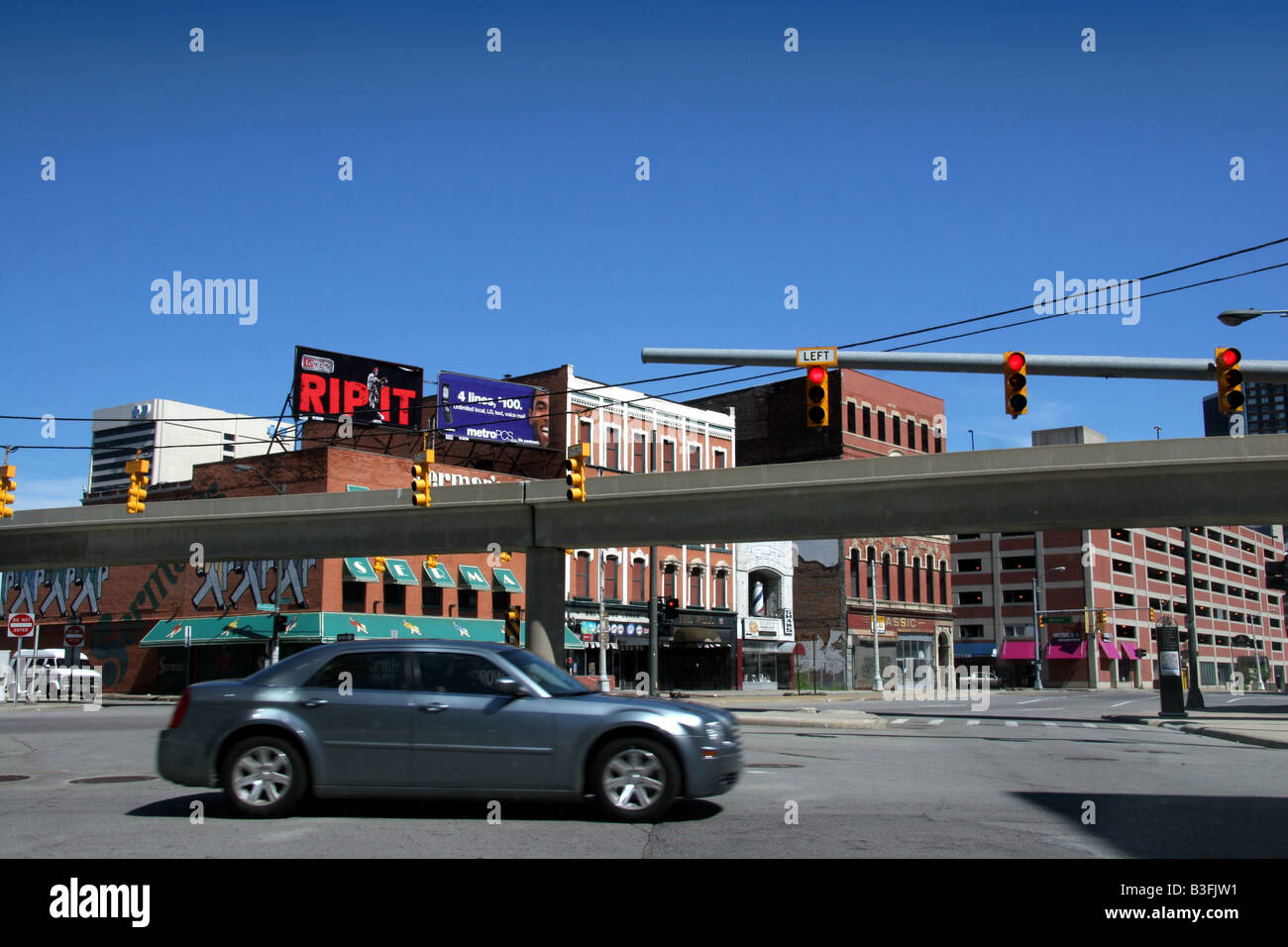 Car driving through a deserted Downtown Detroit, Michigan, USA - Stock Image