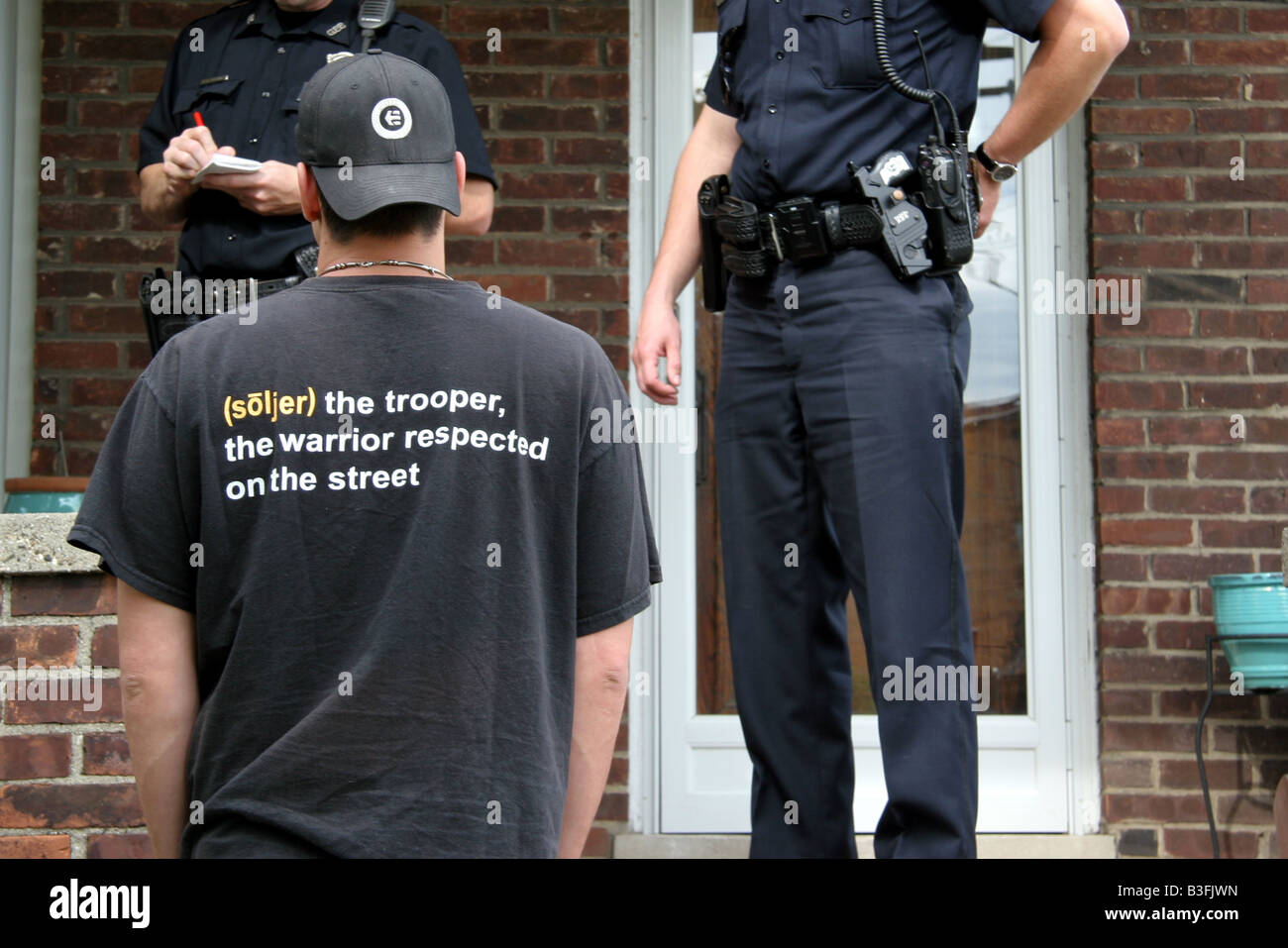 Police officers speaking to a man in Michigan USA - Stock Image