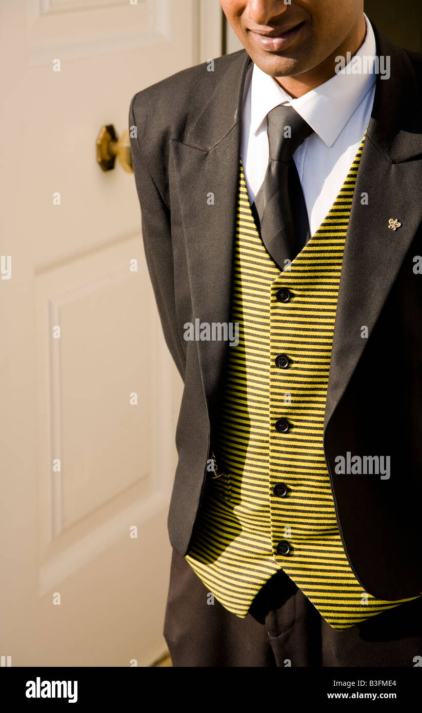 A smartly dressed concierge doorman in his suit. - Stock Image