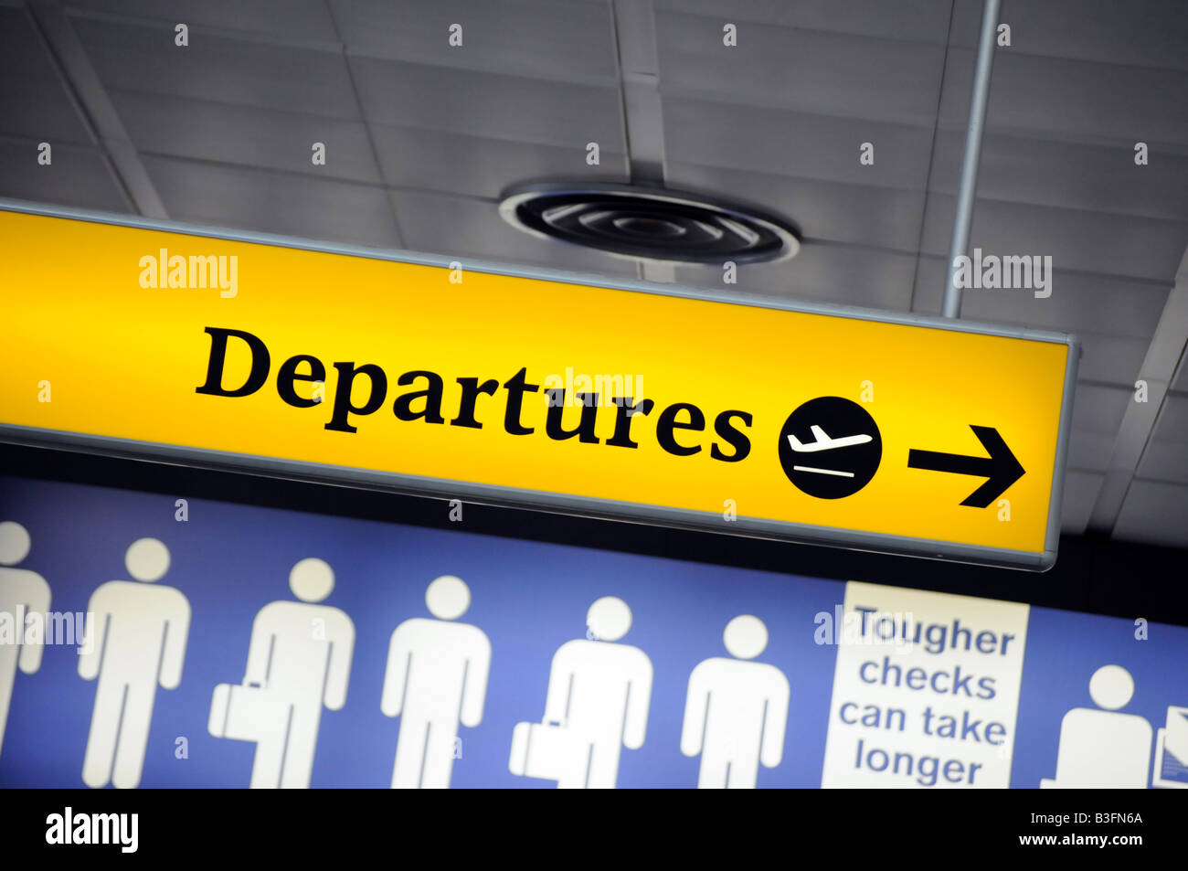 Royalty free photograph of departure sign for emigrating people at airport. - Stock Image