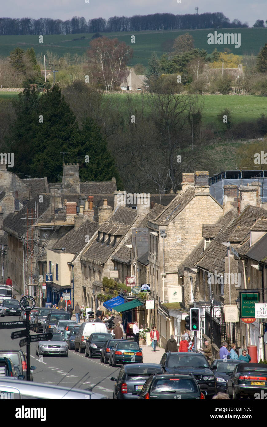 Main Street Cotswold stone houses shops Burford Oxfordshire England UK - Stock Image