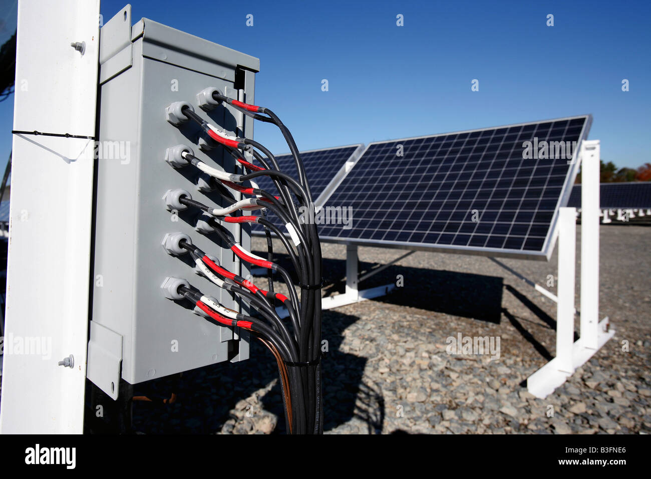 Electrical Wires Enter A Junction Box On The Site Of Solar Powered Power Wiring Electricity Generating Array In Brockton Massachusetts