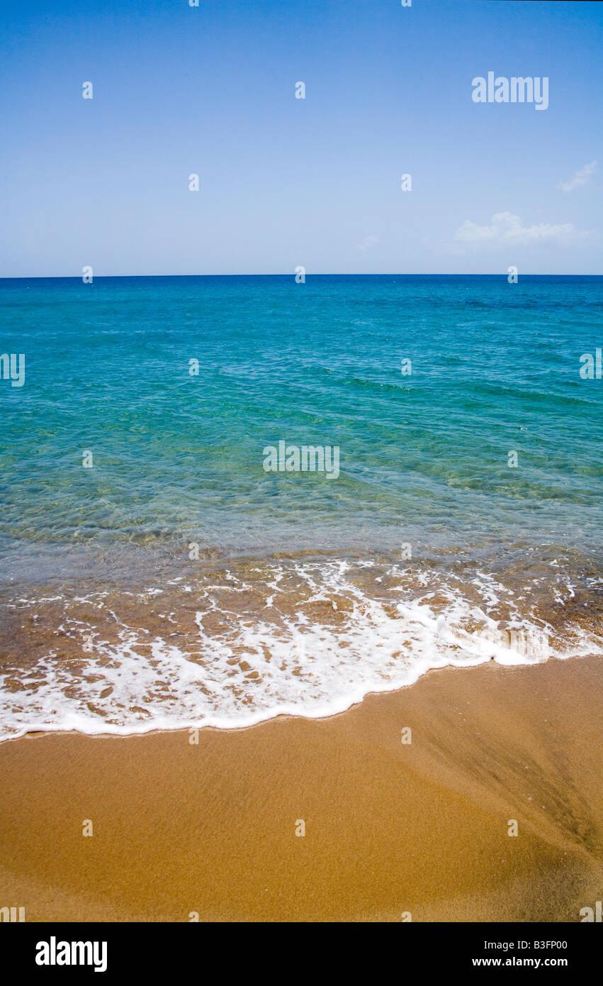 Pristine clean sand beach , sea and sky - Stock Image