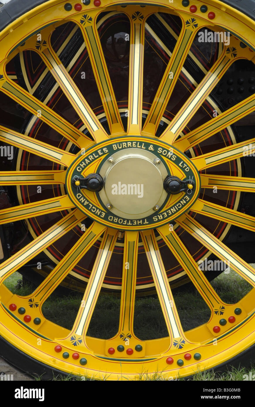 Wheel of a   Charles Burrell showmans steam engine Great Dorset Steam Fair 2008 - Stock Image