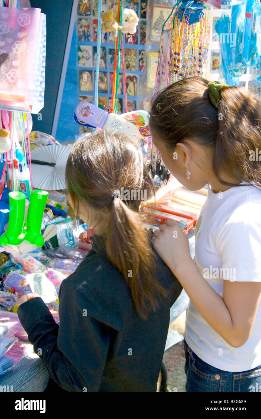Hmong children trying to decide on the purchase at concession stand. Hmong Sports Festival McMurray Field St Paul - Stock Image
