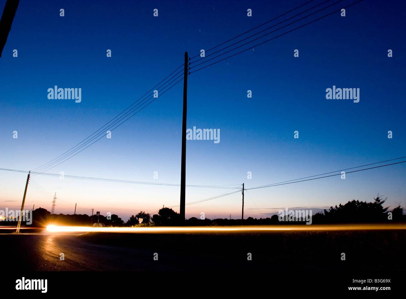 Ray of a motorbike  light at sunset, Formentera - Stock Image