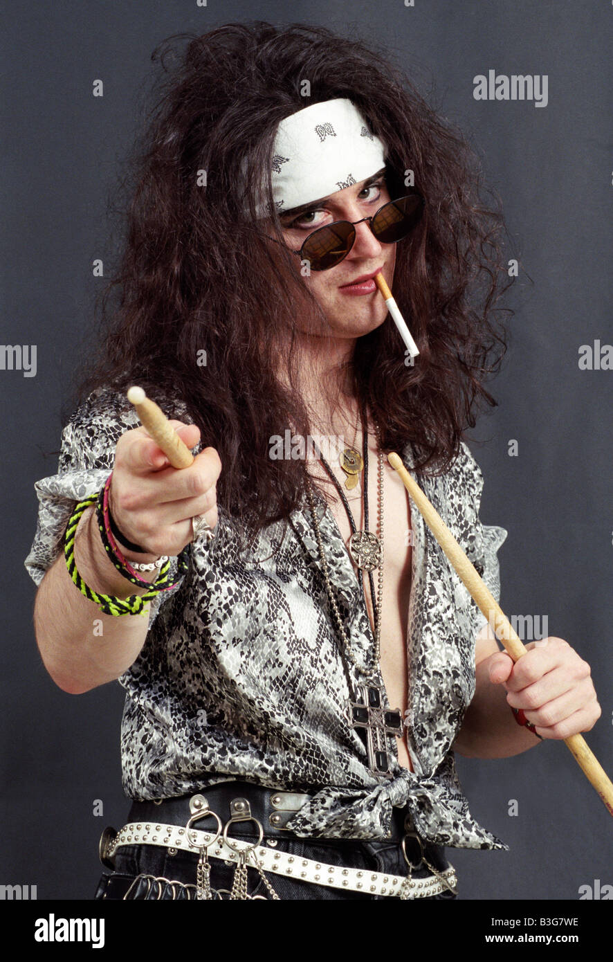 Model Dressed As Heavy Metal Music Star From The 1980s