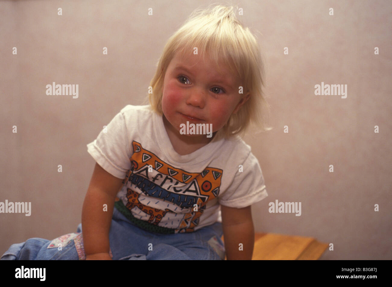 toddler looking angry and unhappy and holding her breath ...