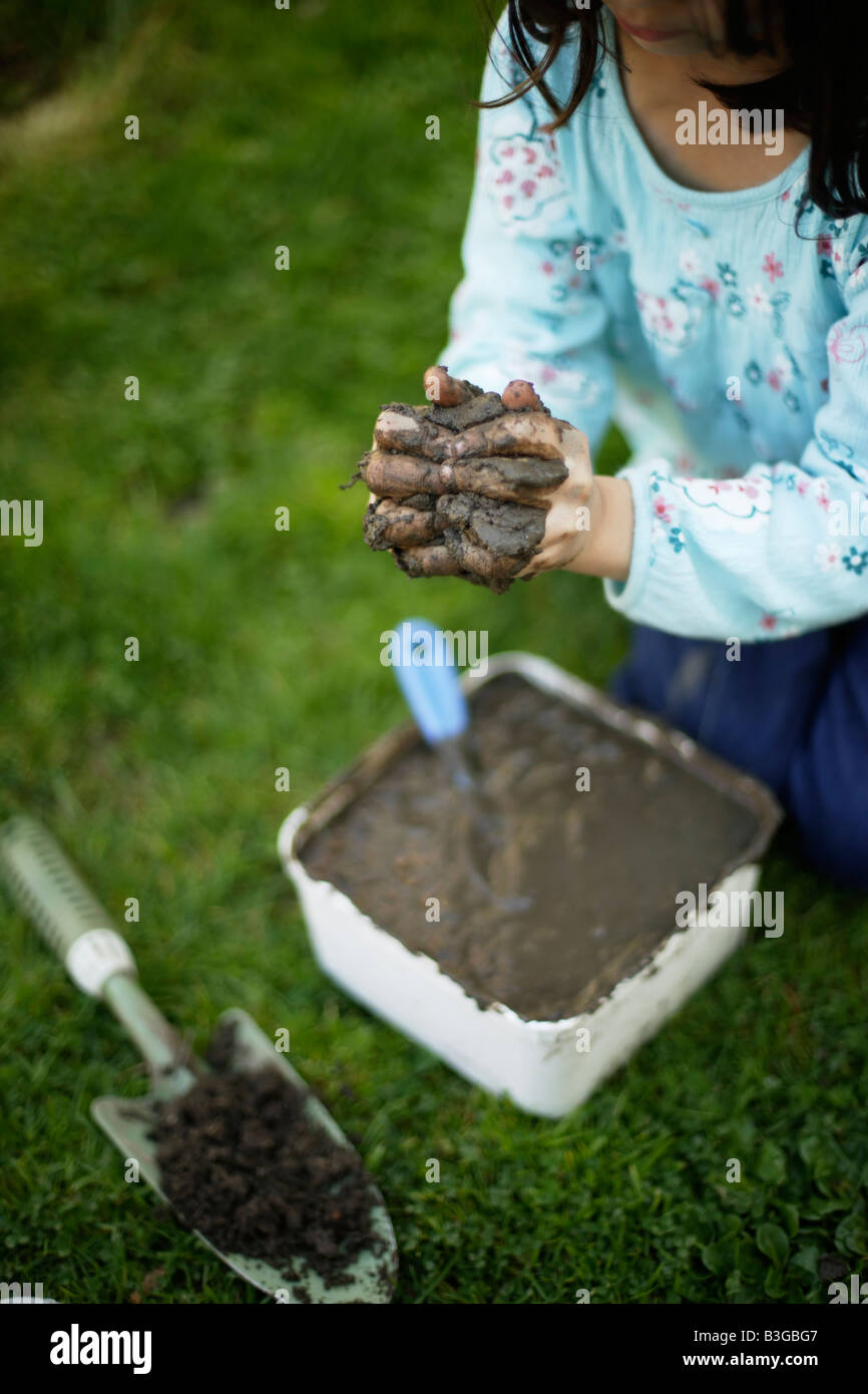 Making mud cakes - Stock Image