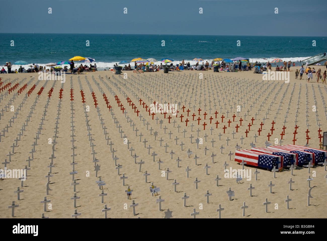 Arlington West memorial, Santa Monica Beach, California. Wooden Cross, Star of David, crescents and Flag drapped - Stock Image