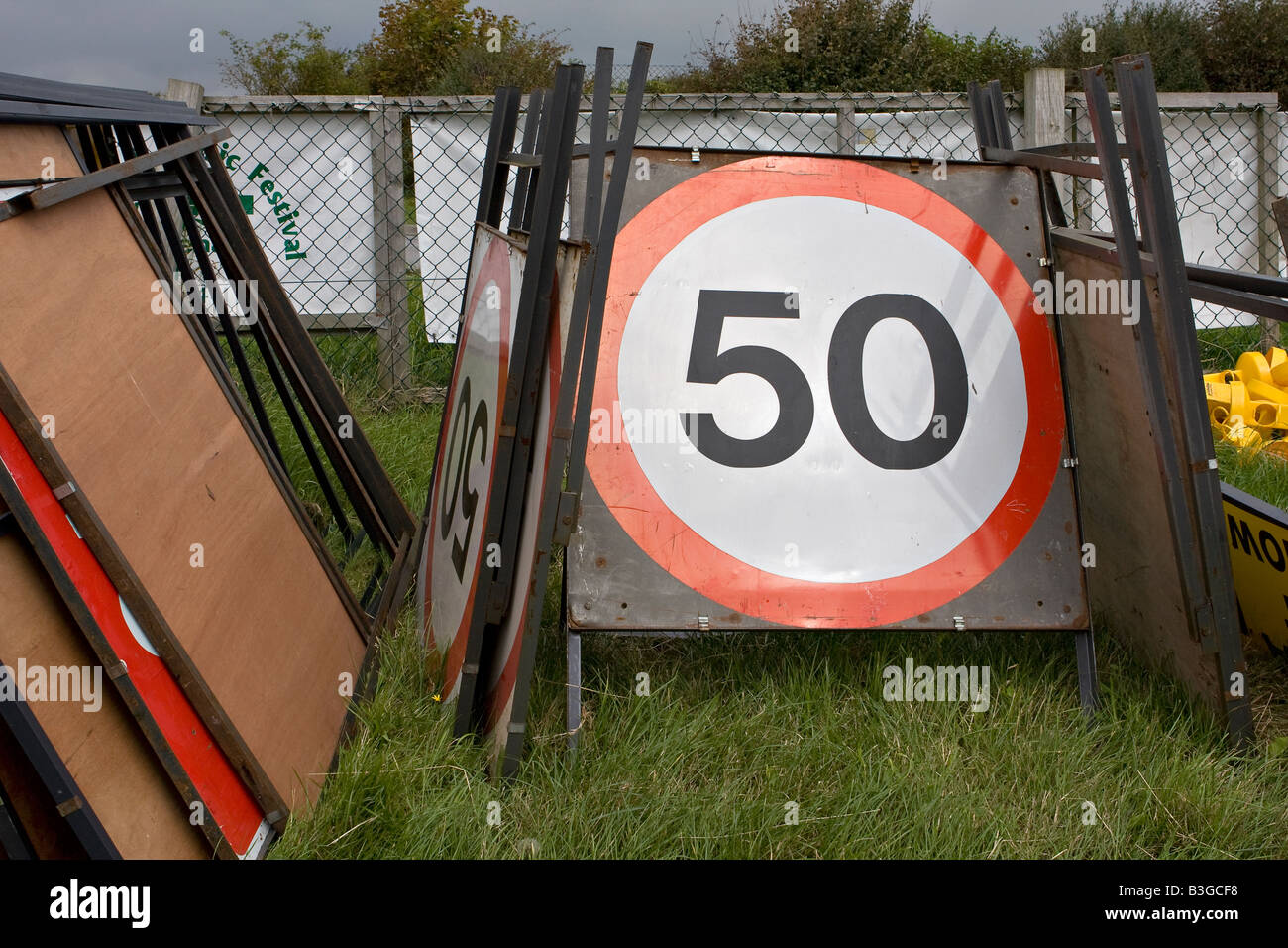 Pile of 50 miles per hour road signs stacked on the ground Sussex England Stock Photo