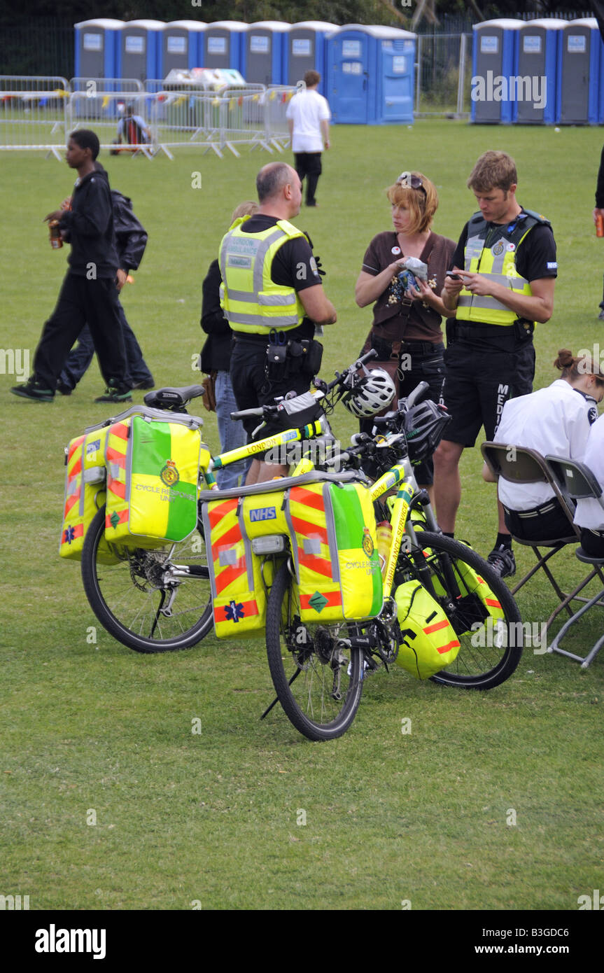 Paramedics cycle response unit having a break at Shoreditch Festival Hackney London England UK - Stock Image