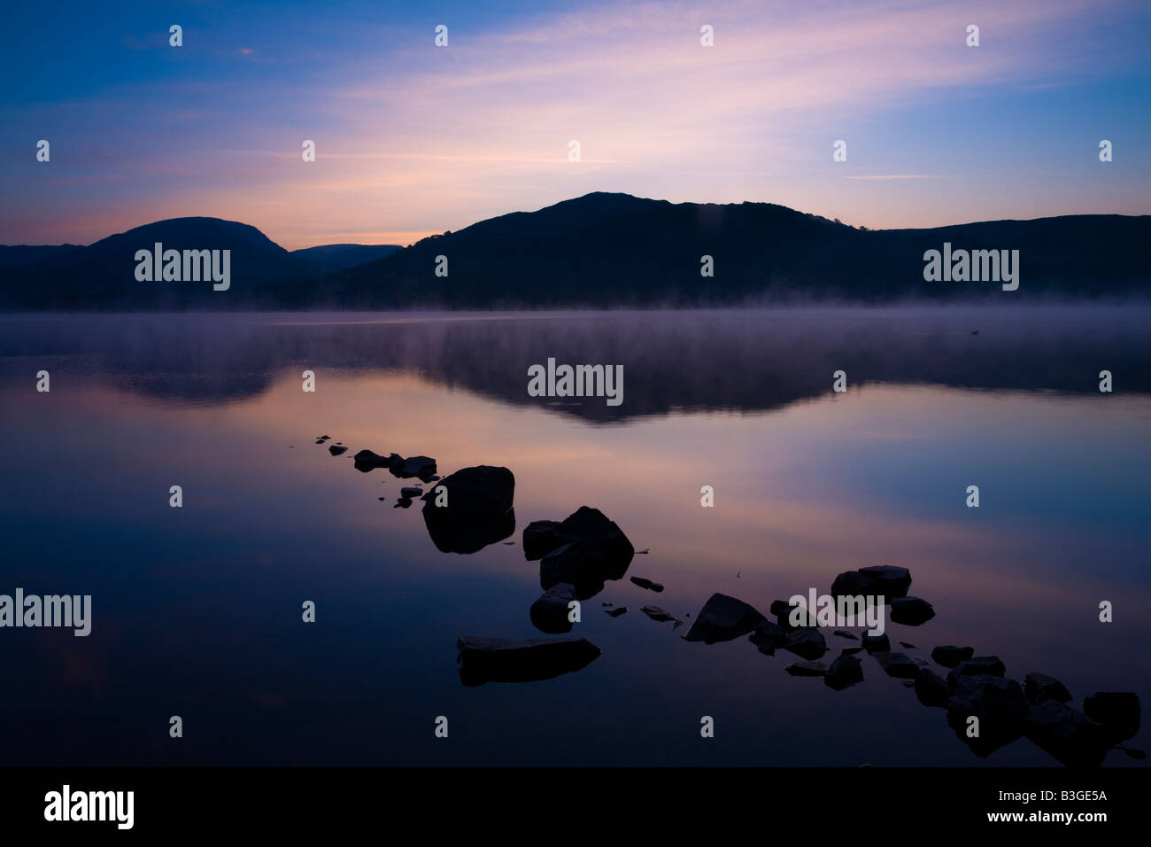 England, Cumbria, Lake District National Park. Dawn at Low Wray, looking across the still waters of Windermere. - Stock Image