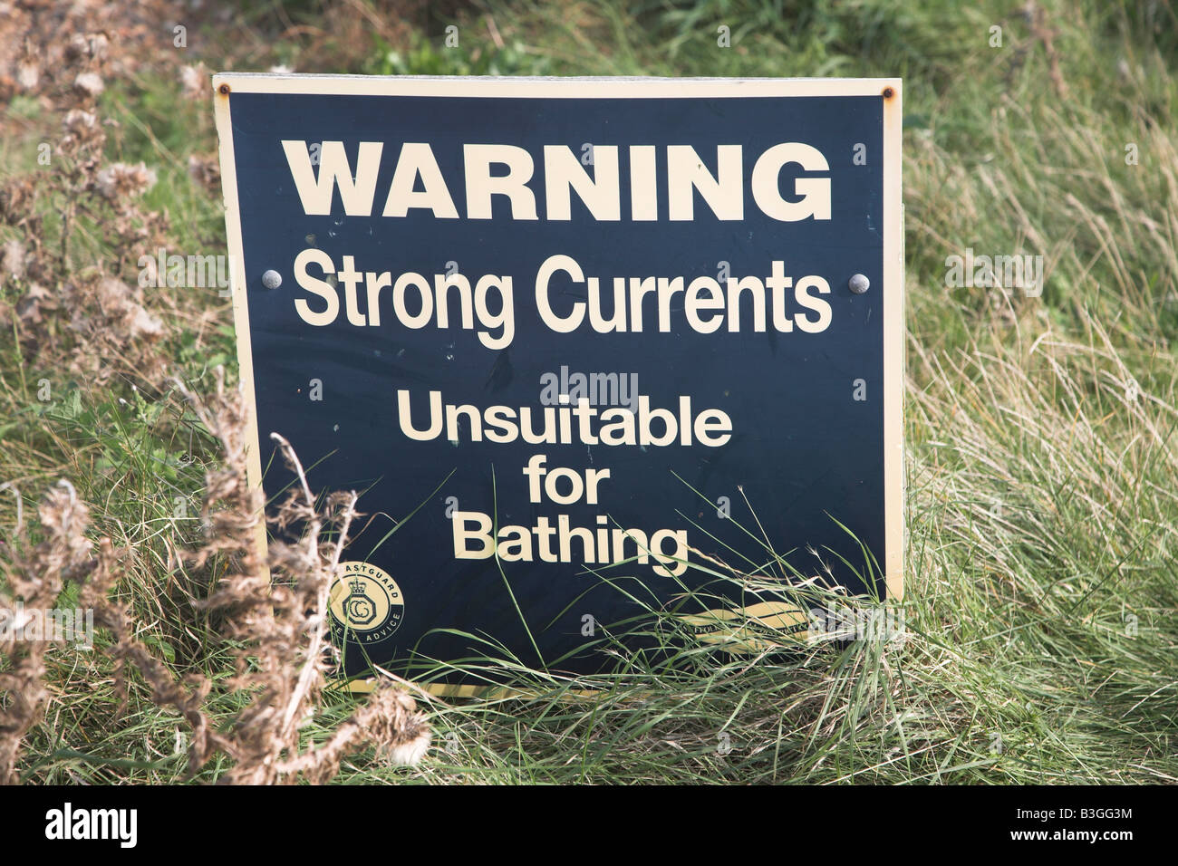 Warning strong currents unsuitable for swimming - Stock Image