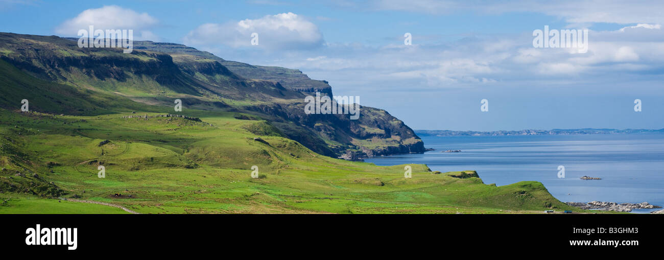 Green hillsides and rugged cliffs rise above Loch Na Keal, Isle of Mull, Scotland - Stock Image