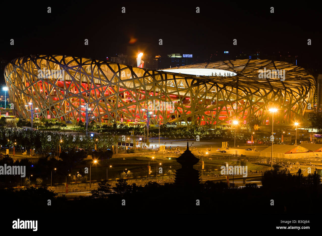 China Beijing The Birds Nest stadium with the Olympic flame Panorama - Stock Image