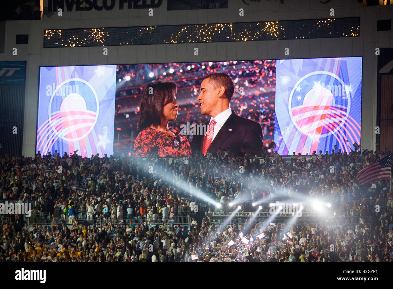 Barack and Michelle Obama embrace after his speech at Invesco Stadium signifying the end of the Democratic National - Stock Image