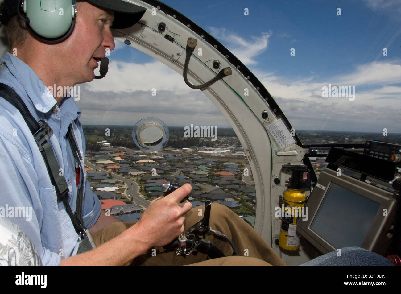 Pilot sitting in cockpit - Stock Image