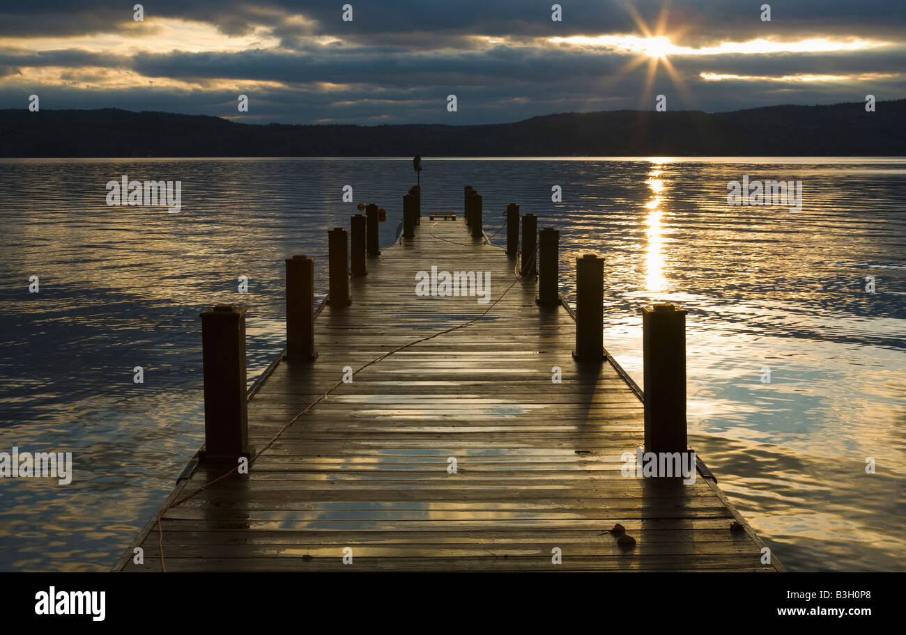 Pier on river at dusk - Stock Image