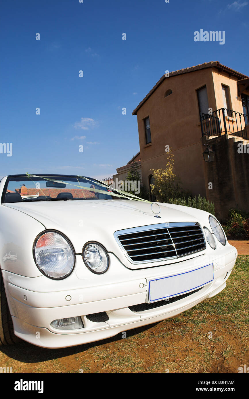 White convertible wedding car with ribbon top down - Stock Image