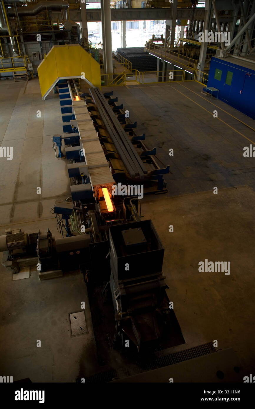 Molten steel on production line to create steel rebar at EISF Steel