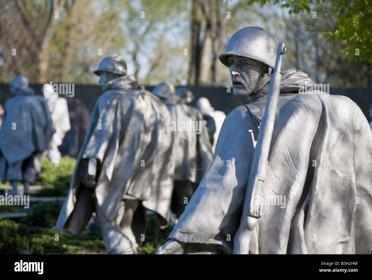 Haunted Look left. A statue of a rifle toting US soldier fighting in Korea with a haunted tired dispirited look - Stock Image