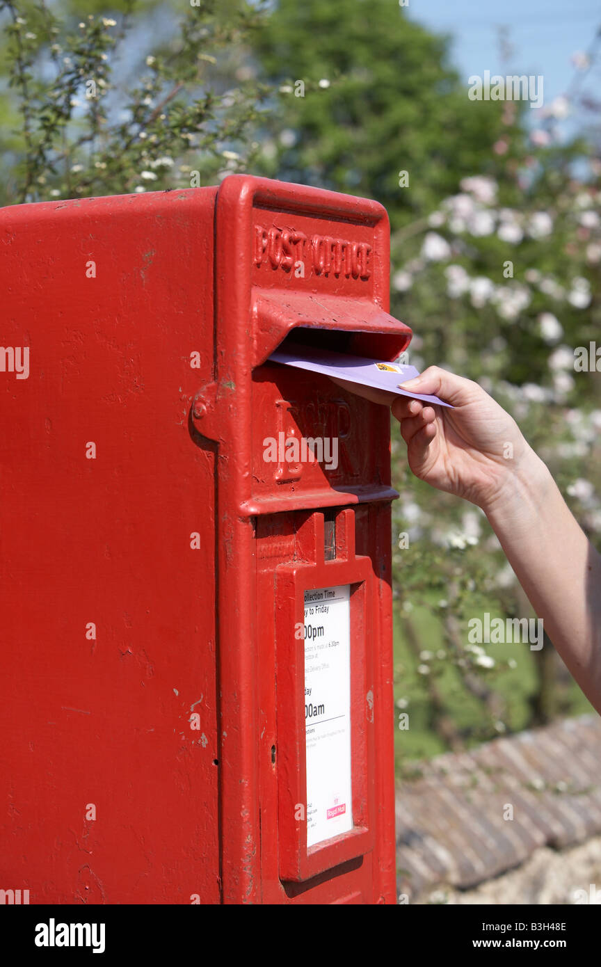 Woman posting a letter - Stock Image