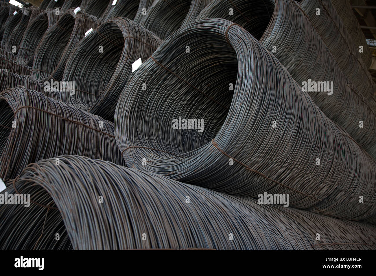 Rolls of Steel rebar wire stacked at steel factory in Abu