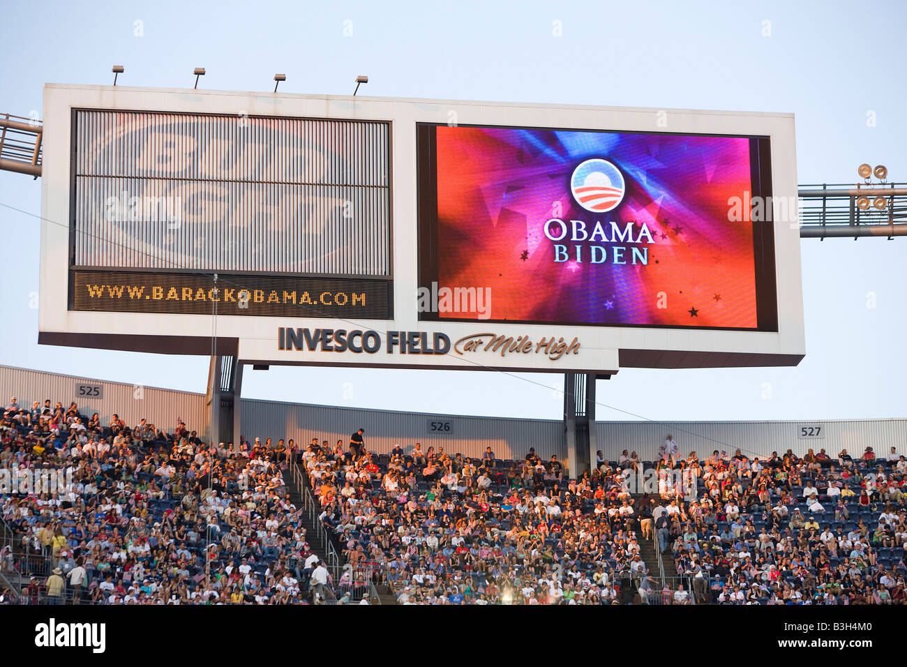 A sign for Obama and Biden pops up as the sun sets over Invesco Field - Stock Image