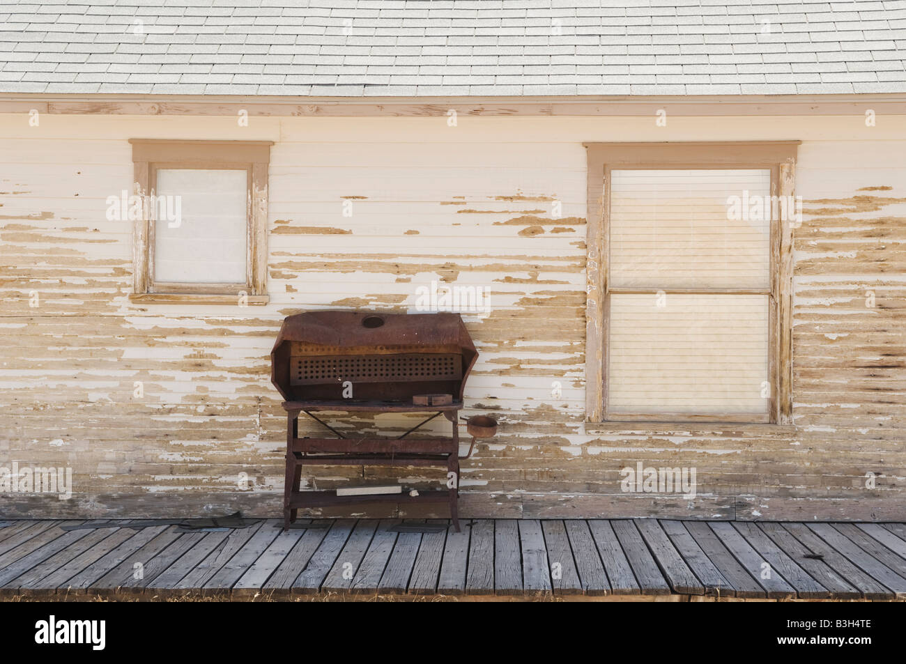 Rusty barbeque on a porch in Rhyolite, Nevada, USA. - Stock Image