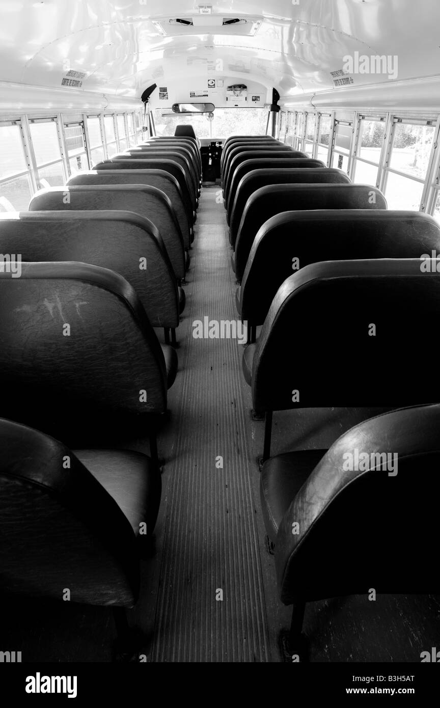 Interior Of Modern School Bus With Isle As Rows Of Seats For Students.